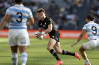 New Zealand's Jordie Barrett, center, gets past the defence of Argentina's Enrique Gomez-Kodela, left, and Argentina's Tomas Cubelli during their Tri-Nations rugby union test at Western Sydney Stadium, in Sydney, Saturday, Nov. 14, 2020. Argentina won the test 25-15. (AP Photo/Rick Rycroft)