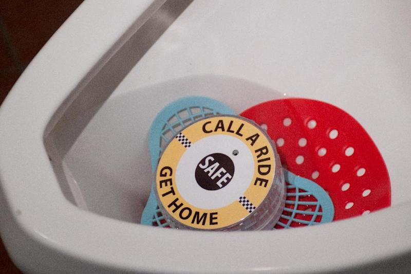 A talking urinal cake installed in the men's restroom at Green Hut, 1301 Columbus Ave. in Bay City, Mich., July 2, 2012. Michigan hopes to keep drunks off the road with the help from a special message in men's bathrooms featuring an attention-getting woman's voice. (AP Photo/The Bay City Times, Yfat Yossifor)