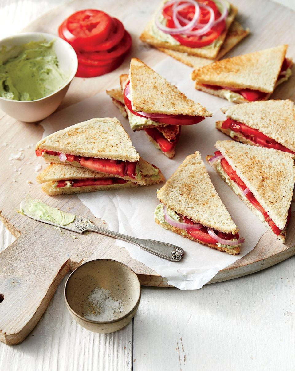 """<p><strong>Recipe: <a href=""""https://www.southernliving.com/recipes/tomato-tea-sandwiches-recipe"""" rel=""""nofollow noopener"""" target=""""_blank"""" data-ylk=""""slk:Tomato Tea Sandwiches"""" class=""""link rapid-noclick-resp"""">Tomato Tea Sandwiches</a></strong></p> <p>You can't go wrong with a classic tomato sandwich. Depending on how many guests you'll be expecting, you may need to double (or triple) this easy recipe. </p>"""
