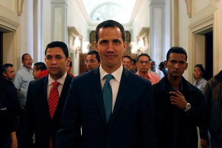 Venezuelan opposition leader Juan Guaido walks at the National Assembly before a news conference in Caracas