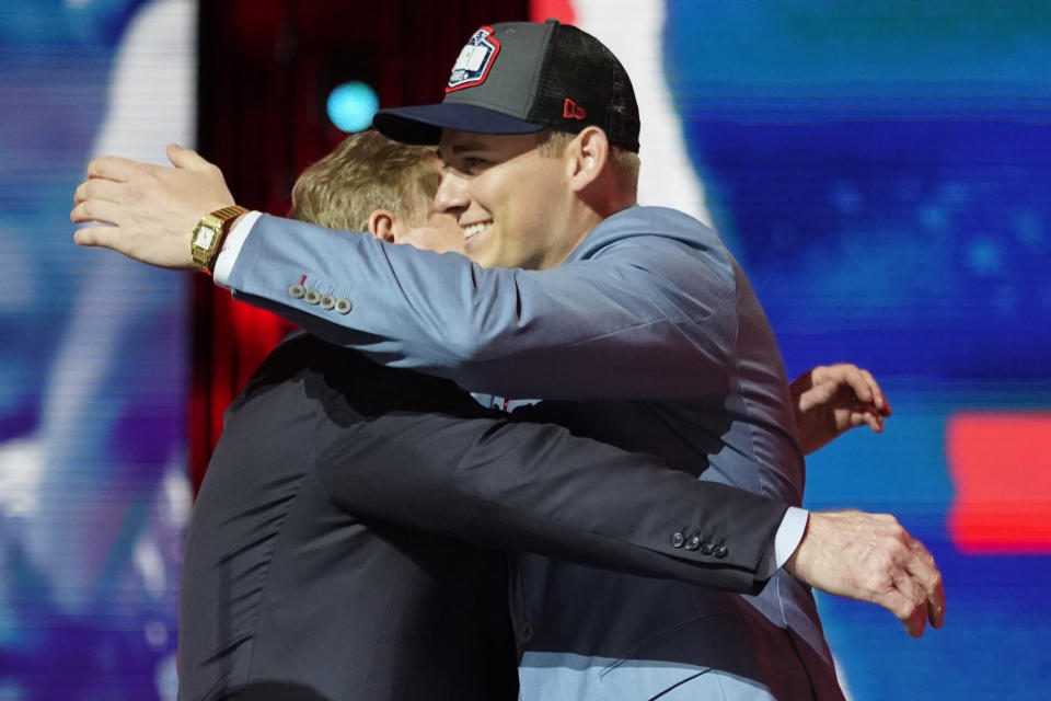 Alabama quarterback Mac Jones, right, greets NFL Commissioner Roger Goodell after he was chosen by the New England Patriots with the 15th pick in the first round of the NFL football draft, Thursday April 29, 2021, in Cleveland. (AP Photo/Tony Dejak)