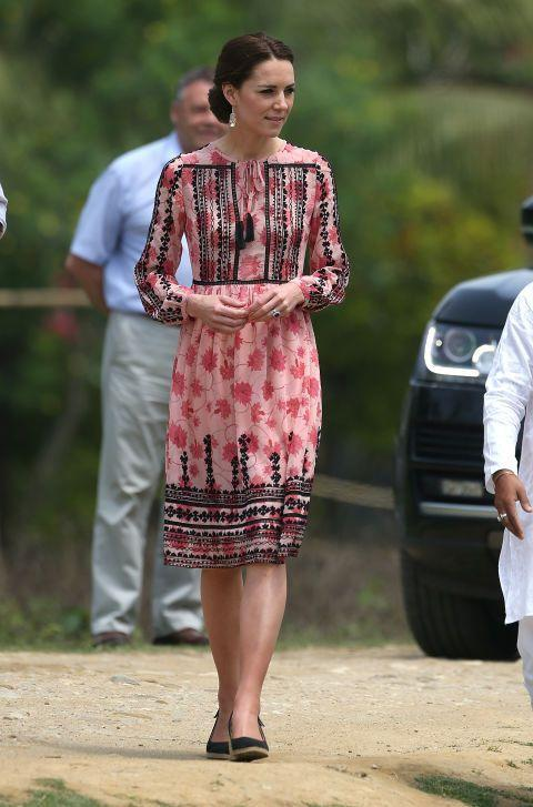 """<p>Kate wore a pink-and-black embroidered <a href=""""http://us.topshop.com/?geoip=home"""" rel=""""nofollow noopener"""" target=""""_blank"""" data-ylk=""""slk:Topshop"""" class=""""link rapid-noclick-resp"""">Topshop</a> dress to the Pan Bari agricultural village in Kaziranga National Park in Guwahati, India. </p>"""