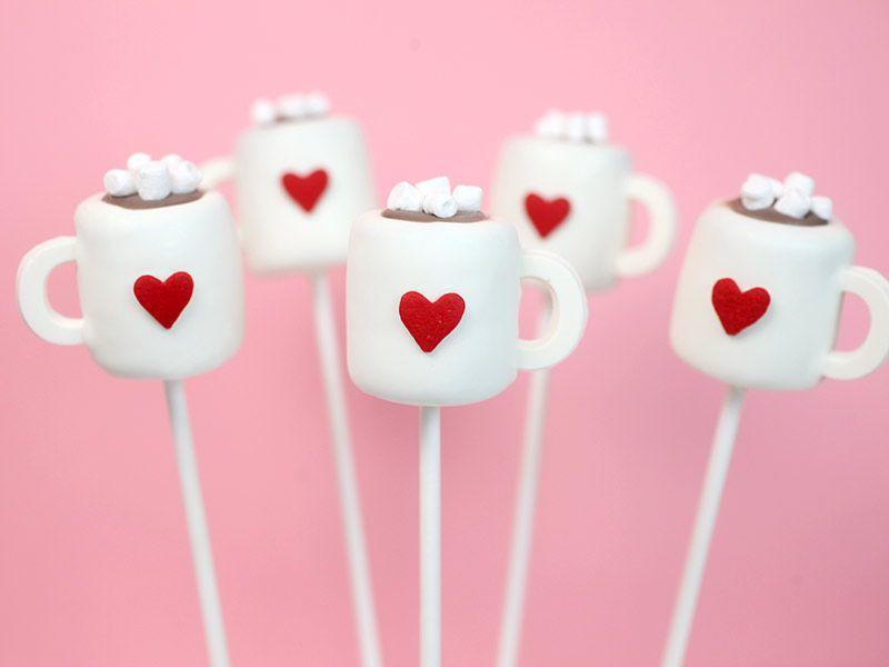 """<p>Enjoy these cocoa cake pops with a mug of <a href=""""https://www.countryliving.com/food-drinks/g2776/hot-chocolate-recipes/"""" rel=""""nofollow noopener"""" target=""""_blank"""" data-ylk=""""slk:homemade hot chocolate"""" class=""""link rapid-noclick-resp"""">homemade hot chocolate</a>.</p><p><strong>Get the recipe at <a href=""""http://www.bakerella.com/cocoa-cake-pops/"""" rel=""""nofollow noopener"""" target=""""_blank"""" data-ylk=""""slk:Bakerella"""" class=""""link rapid-noclick-resp"""">Bakerella</a>. </strong></p><p><a class=""""link rapid-noclick-resp"""" href=""""https://www.amazon.com/Murong-Birthday-Chocolate-Decorating-Silicone/dp/B07467BPSR?tag=syn-yahoo-20&ascsubtag=%5Bartid%7C10050.g.22841709%5Bsrc%7Cyahoo-us"""" rel=""""nofollow noopener"""" target=""""_blank"""" data-ylk=""""slk:SHOP CANDY MOLDS"""">SHOP CANDY MOLDS</a></p>"""