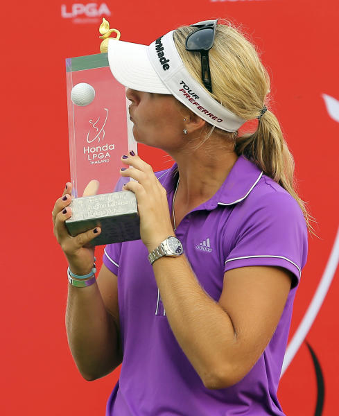 Anna Nordqvist of Sweden kisses her winner's trophy during the awarding ceremony of the LPGA Thailand golf tournament in Pattaya, southern Thailand, Sunday, Feb. 23, 2014. (AP Photo/Siamsport Newspaper) THAILAND OUT