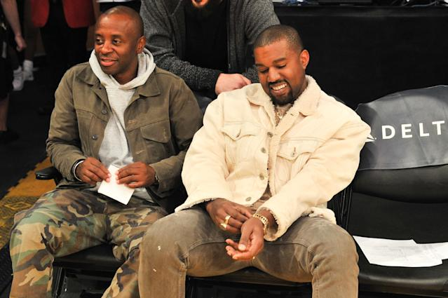 A happy Kanye West attends a Lakers game in L.A. in November 2017. (Photo: Getty Images)