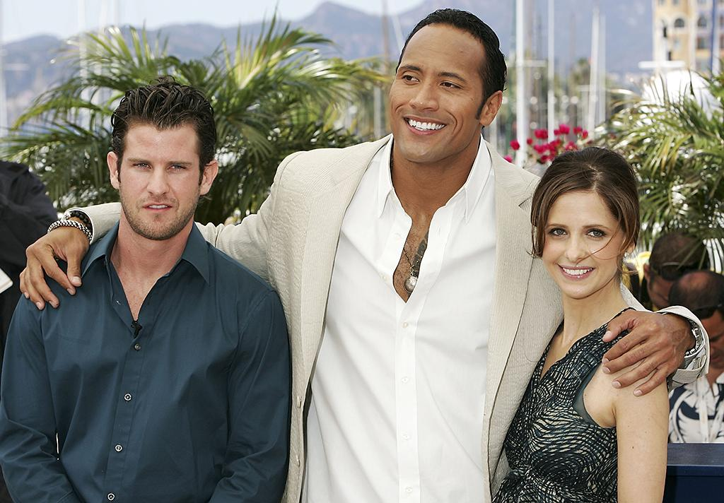 CANNES, FRANCE - MAY 21:  (L-R) Us director Richard Kelly and US actors Dwayne 'The Rock' Johnson and Sarah Michelle Gellar attend a photocall promoting the film 'Southland Tales' at the Palais during the 59th International Cannes Film Festival on May 21, 2006 in Cannes, France.  (Photo by Gareth Cattermole/Getty Images)