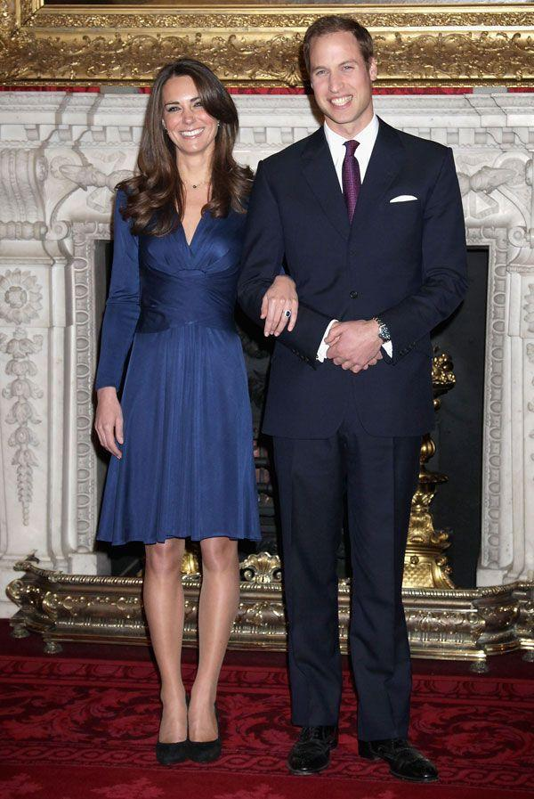 <p>In a navy Issa dress announcing her engagement at St. James Palace</p>