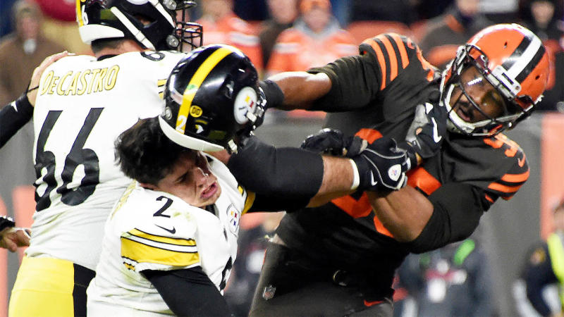Myles Garrett hits Quarterback Mason Rudolph over the head with his helmet during a brawl.