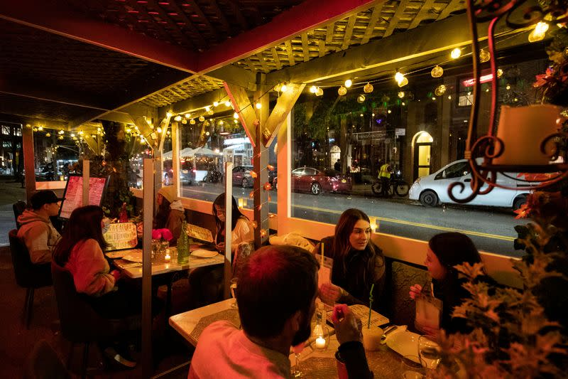 FILE PHOTO: People enjoy outdoor dining at the Sveta restaurant as the spread of the coronavirus disease (COVID-19) continues, in New York City