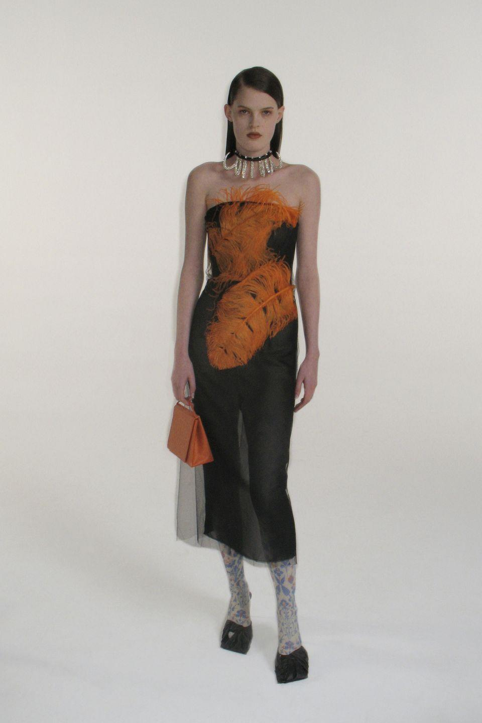 "<p>Last season, 16Arlington put a decidedly casual spin on its usually party-ready pieces and this theme continued for AW21, although that is not to say there wasn't plenty of hopeful glamour injected too.</p><p>Inspired by ""the hypnotic work of artist Hubert Durprat"", the designers attempted to ""contain"" and ""control"" the brand's usual ""out-and-out frivolity"", they explained in their show notes, hoping to offer a fun take on eveningwear, while they reinvented some of the most traditional of pieces, from the shift dress to the flared trouser, with feather detail, sequins, leather and daringly low hemlines.</p><p>See some of our favourite looks below.</p>"