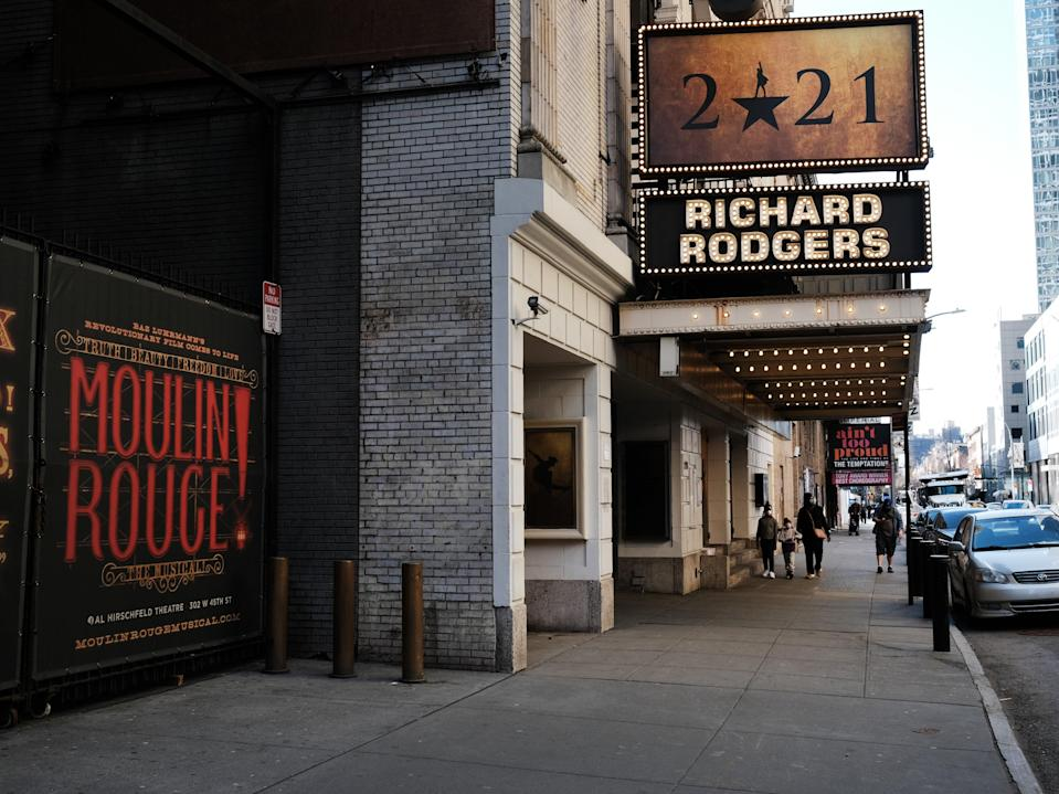 People walk through the empty Broadway theater district one year after it was closed due to Covid-19 restrictions on 12 March 2021 in New York City (Spencer Platt/Getty Images)