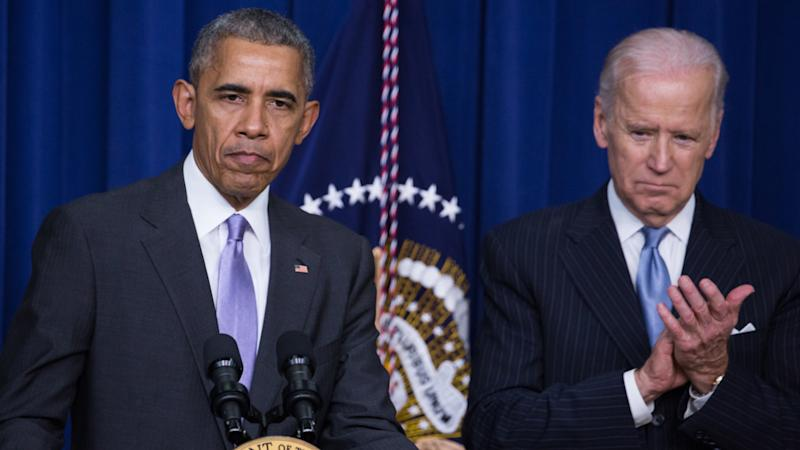 President Barack Obama made remarks, with VP Joe Biden by his side, before signing the 21st Century Cures Act, in the South Court Auditorium of the Eisenhower Executive Office Building of the White House in Washington, DC. on December 13, 2016. (Cheriss May/NurPhoto via Getty Images)