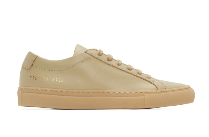 Common Projects Beige Original Achilles Low Sneakers. Image via SSENSE.