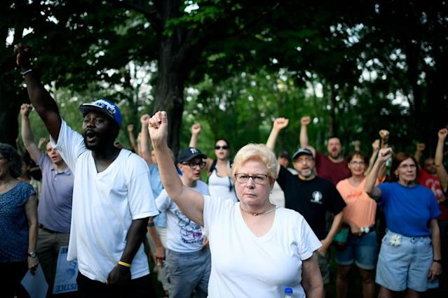 <p>Jan Skogstrom, of Minneapolis, raises her fist with fellow protesters during a march in honor of Justine Damond at Beard's Plaissance Park, Thursday, July 20, 2017, in Minneapolis, Minn. (Photo: Aaron Lavinsky/Star Tribune via AP) </p>