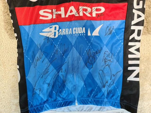 A number of riders from the team, including Dan Martin, Jack Bauer and Dave Zabriskie, have signed the front of the jersey