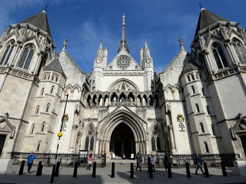 The Royal Courts of Justice in London, where the High Court ruled the Government's policy illegal (PA)