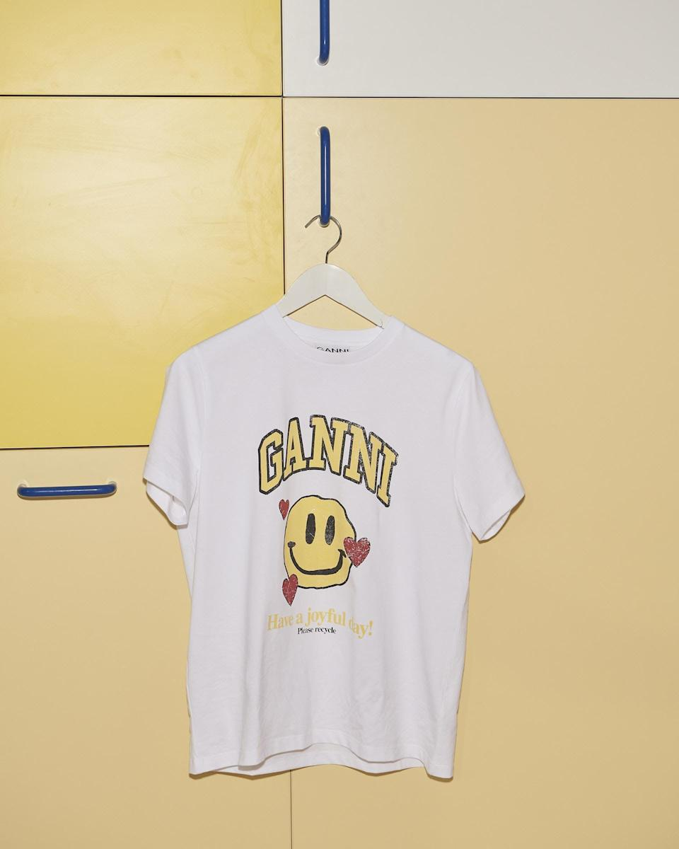"""<p><span>Ganni Smiley Love T-Shirt</span> ($105)</p> <p>""""Ganni's newly-released lineup of tees are just the thing to make your friends and family smile - and add to their everyday look."""" - Hannah Weil McKinley, fashion director </p>"""
