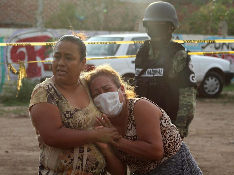 Women react outside a drug rehabilitation facility where assailants killed several people in Mexico: REUTERS