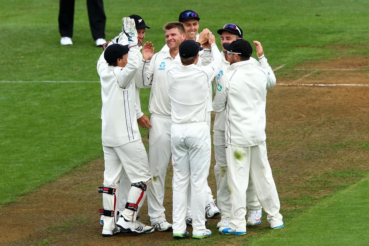 WELLINGTON, NEW ZEALAND - DECEMBER 12:  Corey Anderson of New Zealand is congratulated by teammates after taking the wicket of Kirk Edwards of the West Indies during day two of the Second Test match between New Zealand and the West Indies at Basin Reserve on December 12, 2013 in Wellington, New Zealand.  (Photo by Hagen Hopkins/Getty Images)