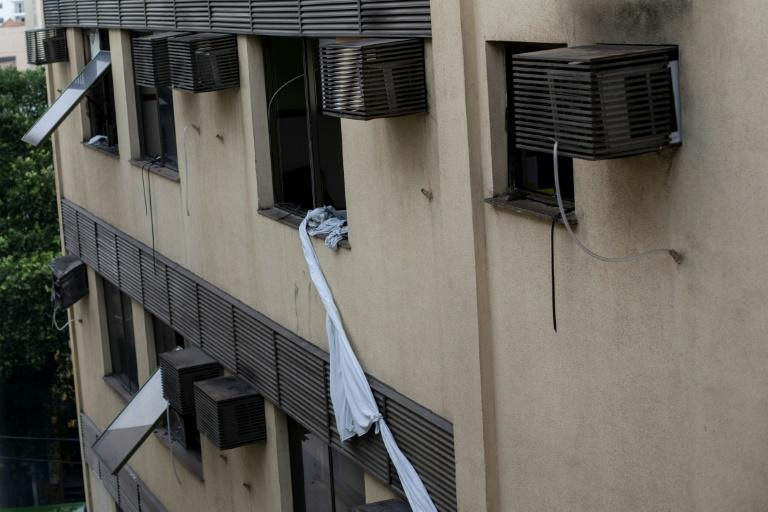 Sheets tied together hang from a window of the Badim hospital in Rio after a deadly fire (AFP Photo/Mauro Pimentel)
