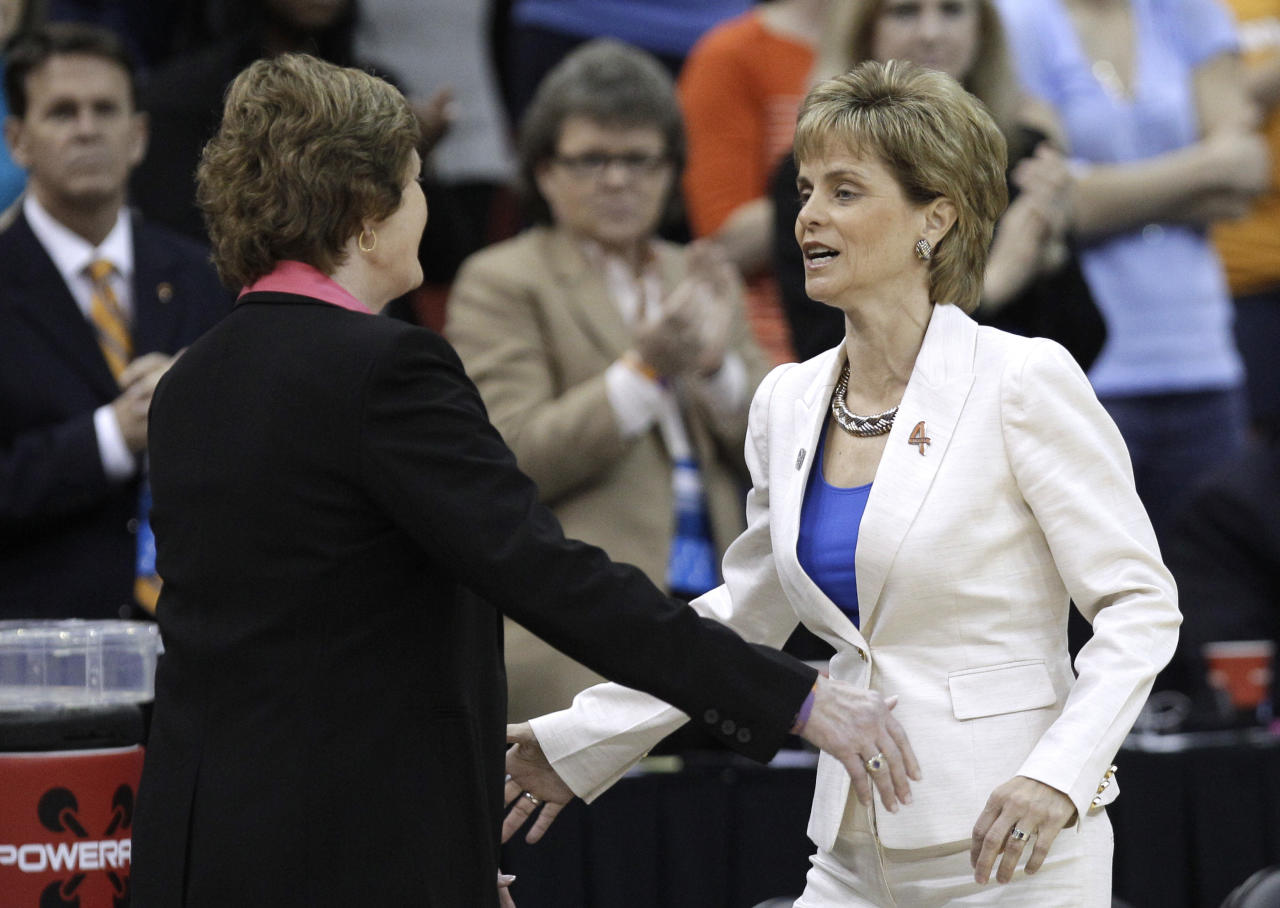 Tennessee coach Pat Summitt, left, greets Baylor coach Kim Mulkey before an NCAA women's college basketball tournament regional final, Monday, March 26, 2012, in Des Moines, Iowa. (AP Photo/Charlie Neibergall)
