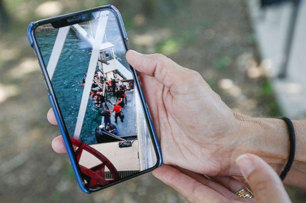 PHOTO: Sonja Malaske, of Harrah, Okla., shows a picture she took from the Branson Belle of people being pulled from the water after a duck boat capsized on Table Rock Lake in Branson, Mo., July 20, 2018. (Andrew Jansen/Springfield News-Leader via USA Today Network)