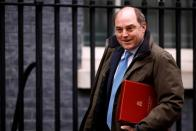 FILE PHOTO: Britain's Defence Secretary Ben Wallace walks outside Downing Street in London