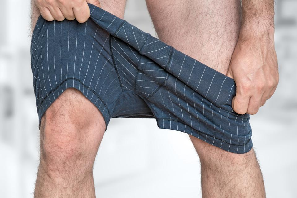 Man puts on or undressing his underpants