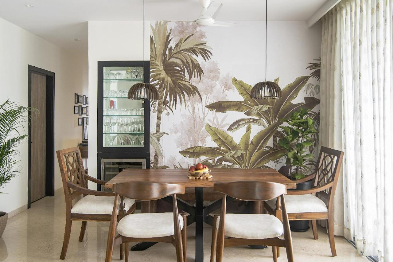 The dining area is the showstopper with its botanical wallpaper that breathes life into the tropical theme of the home.