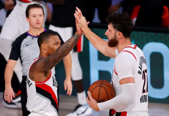 Lillard rebounds with 51, Blazers top Sixers as Embiid hurt
