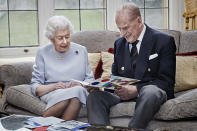 """<p>Jackson took one of the last images of the Queen and Prince Philip as the couple celebrated their 73rd wedding anniversary in November 2020 amid COVID-19 lockdowns.</p> <p>The photographer captured the pair opening a homemade anniversary card from Prince George, Princess Charlotte and Prince Louis. """"The card featured a multicolored '73' on the front. The Duke's face lit up as he opened it,"""" writes Jackson. """"I loved that link between one generation and another at a time when families were unable to meet in person. It was such a special, genuine moment.""""</p>"""