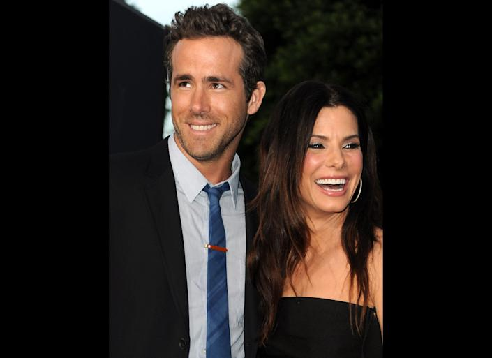 LOS ANGELES, CA - AUGUST 01: Actors Ryan Reynolds (L) and Sandra Bullock arrive at the premiere of Universal Pictures' 'The Change-Up' held at the Regency Village Theatre on August 1, 2011 in Los Angeles, California. (Photo by Kevin Winter/Getty Images)