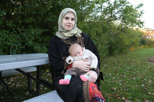 Caitlan Coleman holds her infant daughter as she speaks to the Toronto Star from the grounds of a hospital in Ottawa in her first interview since the family's rescue from militants.