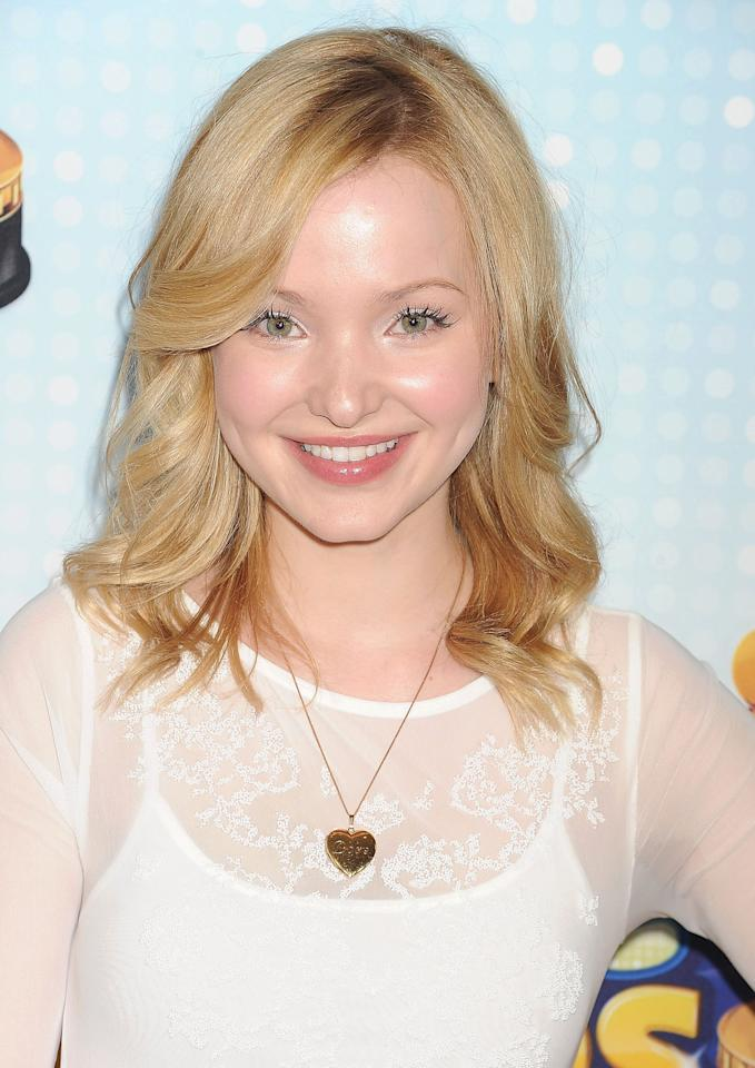 <p>Cameron attended the 2013 Radio Disney Music Awards with medium-length waves and sideswept bangs.</p>