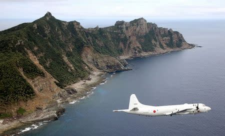 File photo of Japan Maritime Self-Defense Force's PC3 surveillance plane flying around disputed islands in the East China Sea known as the Senkaku isles in Japan and Diaoyu in China
