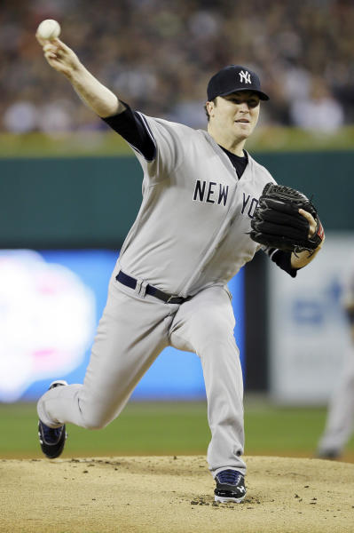 New York Yankees' Phil Hughes throws in the first inning during Game 3 of the American League championship series against the Detroit Tigers Tuesday, Oct. 16, 2012, in Detroit. (AP Photo/Matt Slocum)