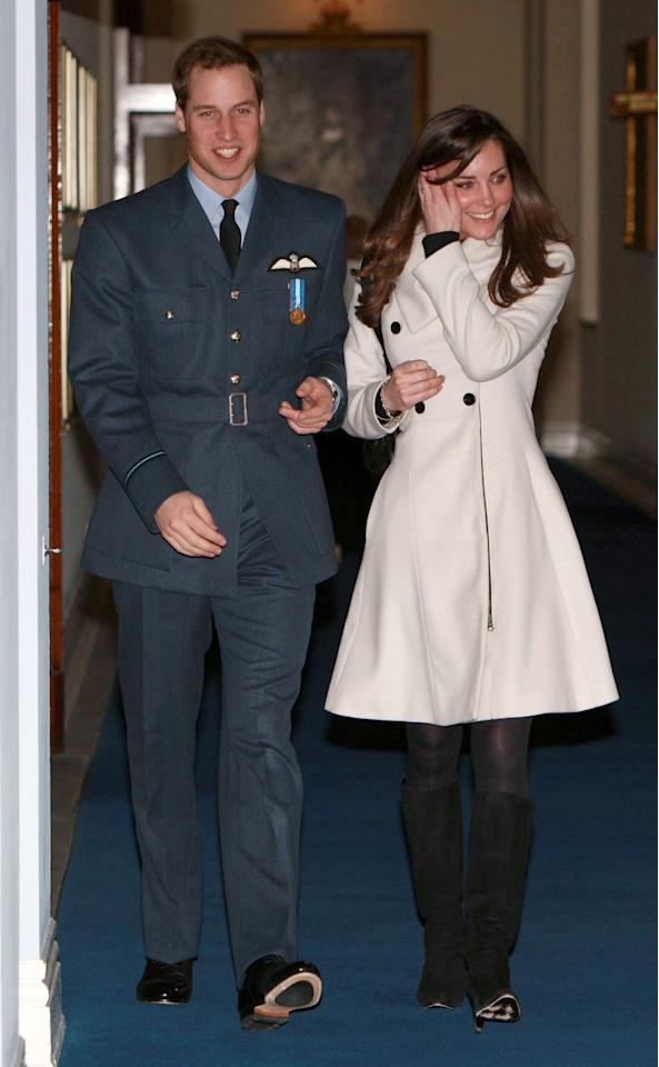 Britain's Prince William and his girlfriend Kate Middleton walk in RAF Cranwell, England after William received his RAF wings from his father the Prince of Wales Friday April 11, 2008. Prince William was presented with his ceremonial pilot's wings Friday by his father Prince Charles, as he graduated as a military pilot and followed in the footsteps of a host of his royal ancestors. The young prince's girlfriend Kate Middleton and his father's wife, Camilla, watched on as William passed out with his class of colleagues.   (AP Photo/Michael Dunlea, Pool)