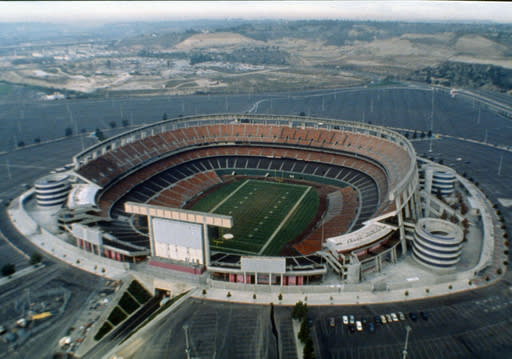 FILE - This 1987 file photo shows an aerial view of Jack Murphy Stadium in San Diego, Calif., site of Super Bowl XXII. Now the stadium is coming to an unceremonious end, leaving generations of fans feeling melancholy because, due to the coronavirus pandemic, they didn't get to say a proper goodbye to the place where they tailgated with gusto in the massive parking lot before cheering on the Chargers, Padres and Aztecs, or watched myriad other events and concerts. (AP Photo/File)