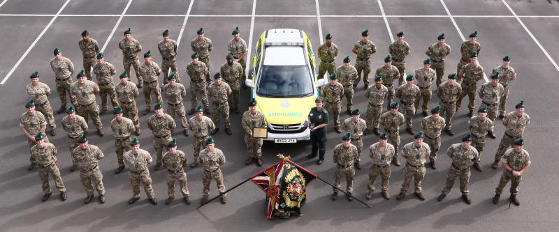 Ambulance Operations Manager Heather Ransom presents a commemorative plaque to the 1st Battalion Royal Irish Regiment at Shropshire's Clive Barracks