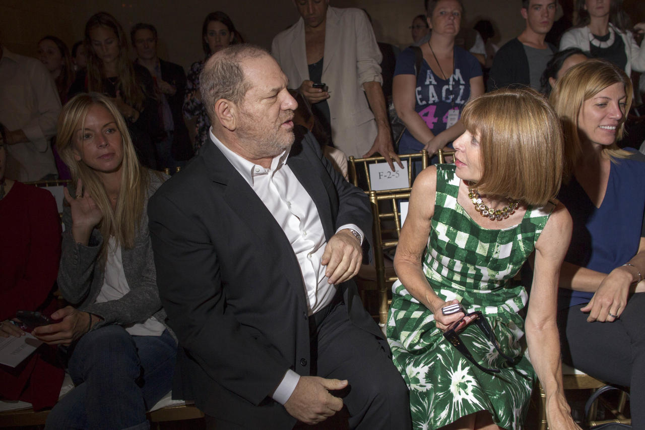 IMAGE DISTRIBUTED FOR FIJI WATER - Harvey Weinstien, left, and Anna Wintour attend the FIJI Water-sponsored Marchesa Spring 2013 Fashion Show at Vanderbilt Hall on Wednesday Sept. 12, 2012, in New York. (Photo by Victoria Will/Invision for FIJI Water /AP Images)