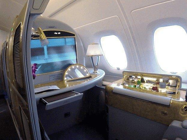 <p>My first impression of the First Class Suite was WOW. You see the pictures online, but only when you actually sit down do you realize how over the top the Suite really is. There is bling everywhere; gold trimmings line pretty much everything from the table to the LCD screen to the adjustable air duct. <i>(Photo: Sam Huang)</i><br></p>
