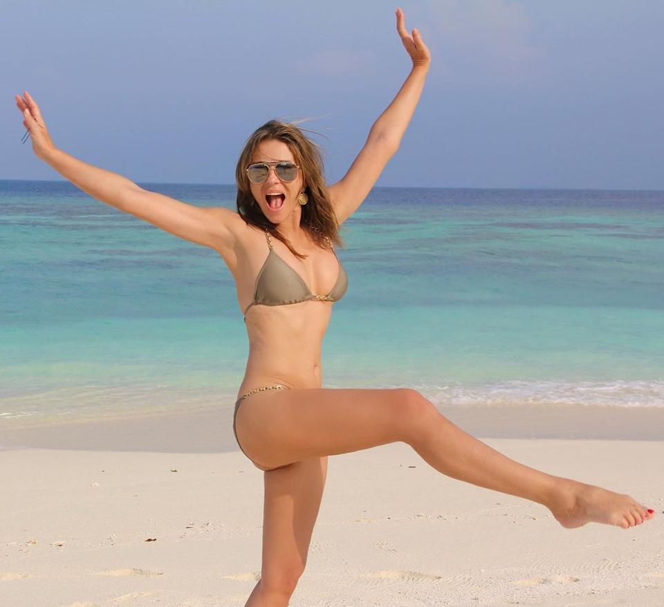 Elizabeth Hurley posing in a bikini on a beach