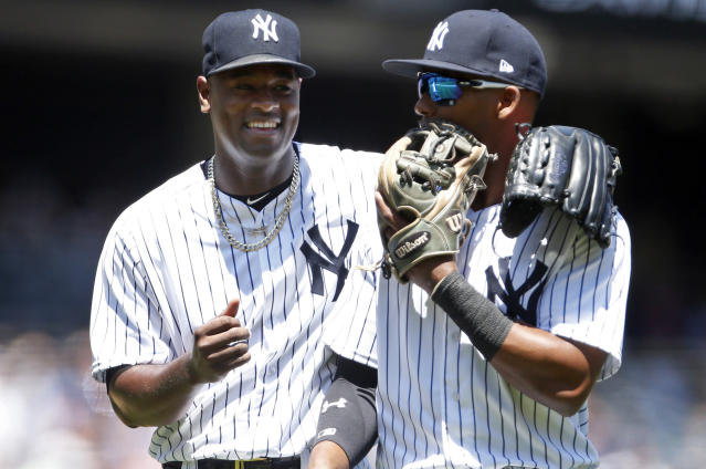 New York Yankees pitcher Luis Severino, left, laughs with third baseman Miguel Andujar as they walk back to the dugout during the first inning of a baseball game against the Tampa Bay Rays on Saturday, June 16, 2018, in New York. (AP Photo/Adam Hunger)