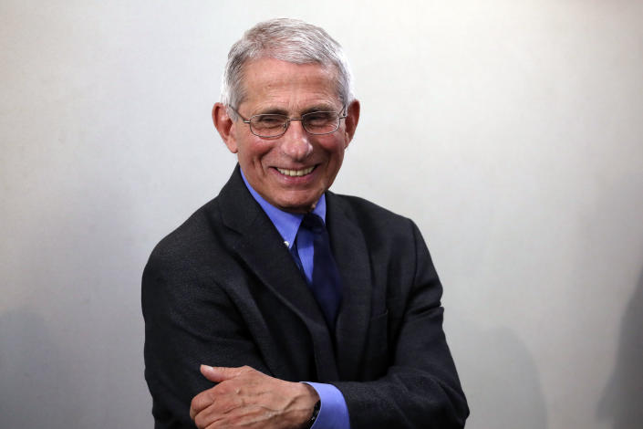 Dr. Anthony Fauci, director of the National Institute of Allergy and Infectious Diseases, stands before President Donald Trump arrives to speak about the coronavirus in the James Brady Press Briefing Room at the White House, Monday, April 13, 2020, in Washington. (AP Photo/Alex Brandon)