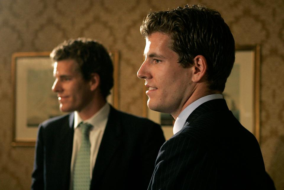 FILE - In this July 25, 2007 file photo, twin brothers Cameron, left, and Tyler Winklevoss, founders of ConnectU, talk with reporters following a news conference in Boston. Cameron and Tyler Winklevoss are no strangers to the spotlight. After waging a closely watched legal battle with Facebook Inc., the Greenwich natives and Olympic rowers know all too well what it's like to be scrutinized in newspapers, blogs and books. Now they're preparing to see their story told once again, this time, on the big screen. (AP Photo/Charles Krupa, File)