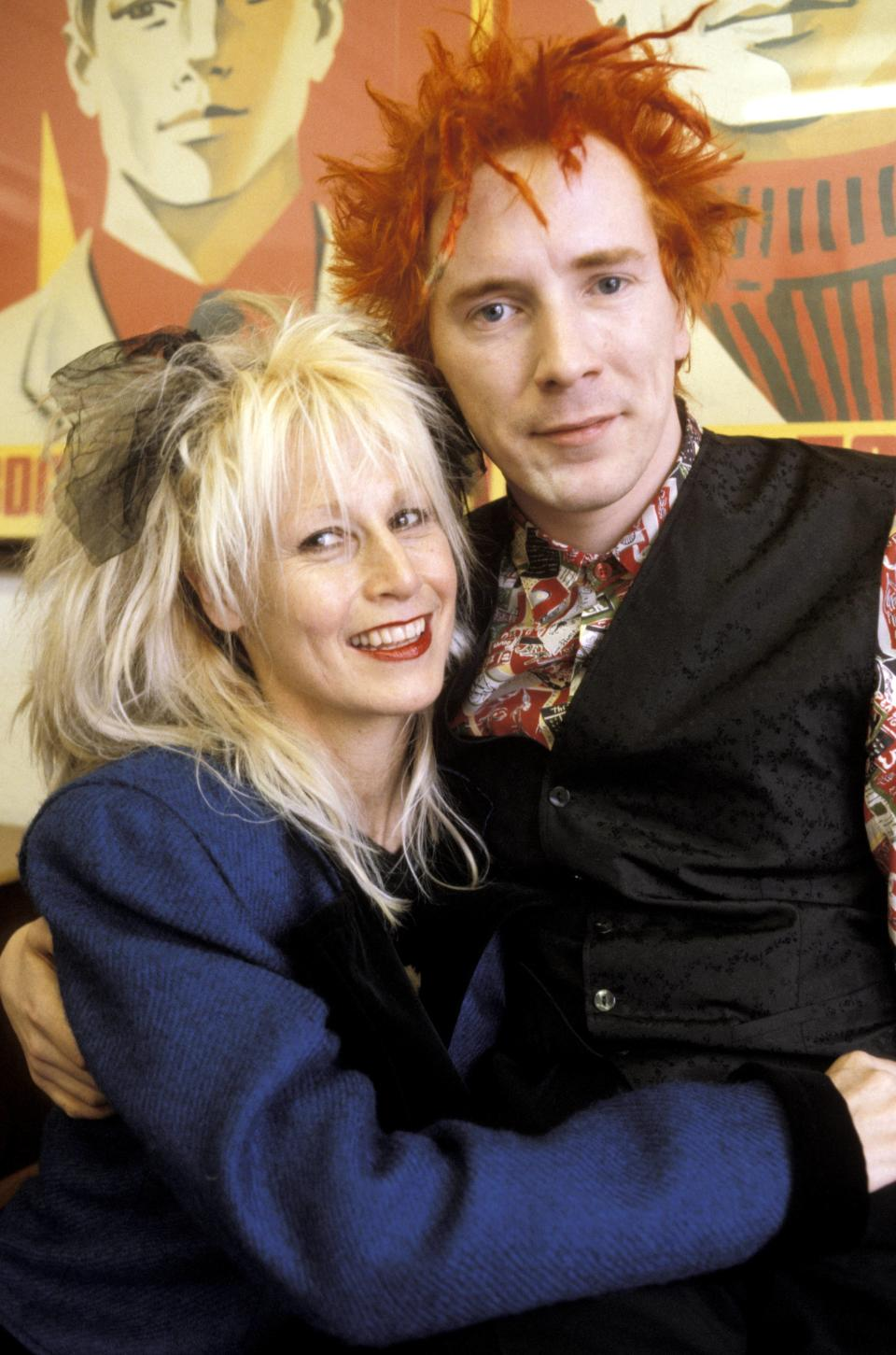 John Lydon posing with his wife Nora Forster. (Photo by Fin Costello/Redferns)