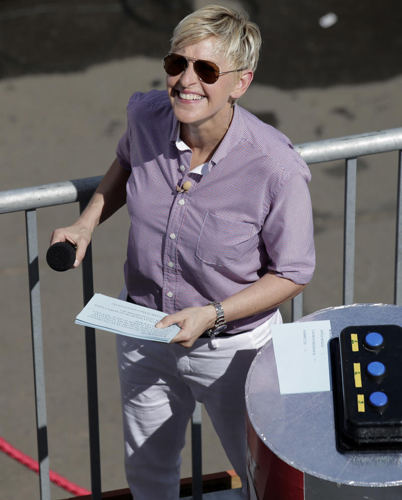 U.S. talk show host Ellen DeGeneres prepares for a segment of her show that she is recording in Sydney, Australia, Saturday, March 23, 2013. (AP Photo/Rick Rycroft)