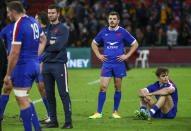 French players react following their loss to Australia in the third rugby international at Suncorp Stadium in Brisbane, Australia, Saturday, July 17, 2021. (AP Photo/Tertius Pickard)