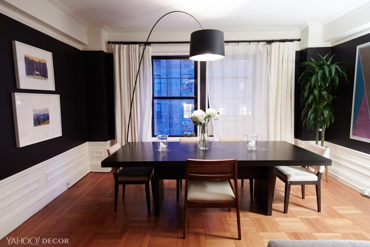 """<p>""""It just <i>barely</i> clears the ceiling,"""" says Neff, of his statement-making Foscarini lamp. He and his roommate had a lot of trouble figuring out where it would fit into the apartment before finally realizing that it was the perfect accent to their dining table and chairs, which come from Restoration Hardware.</p>"""