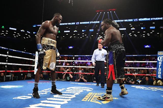 Deontay Wilder stares down Bermane Stiverne after knocking him down and the fight resumed in the first round, during their rematch for Wilder's WBC heavyweight title, at the Barclays Center in New York, on November 4, 2017 (AFP Photo/AL BELLO)